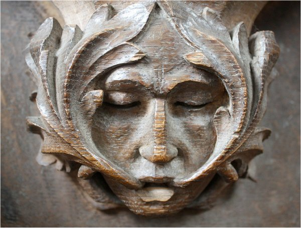 Green man/foliate head from St Mary's Church Adderbury. Image credit: Richardr, 2011.